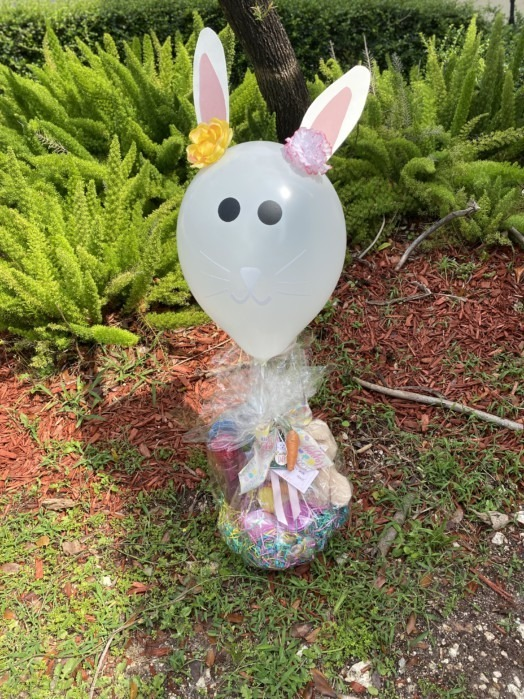 Bunny balloon in top of basket